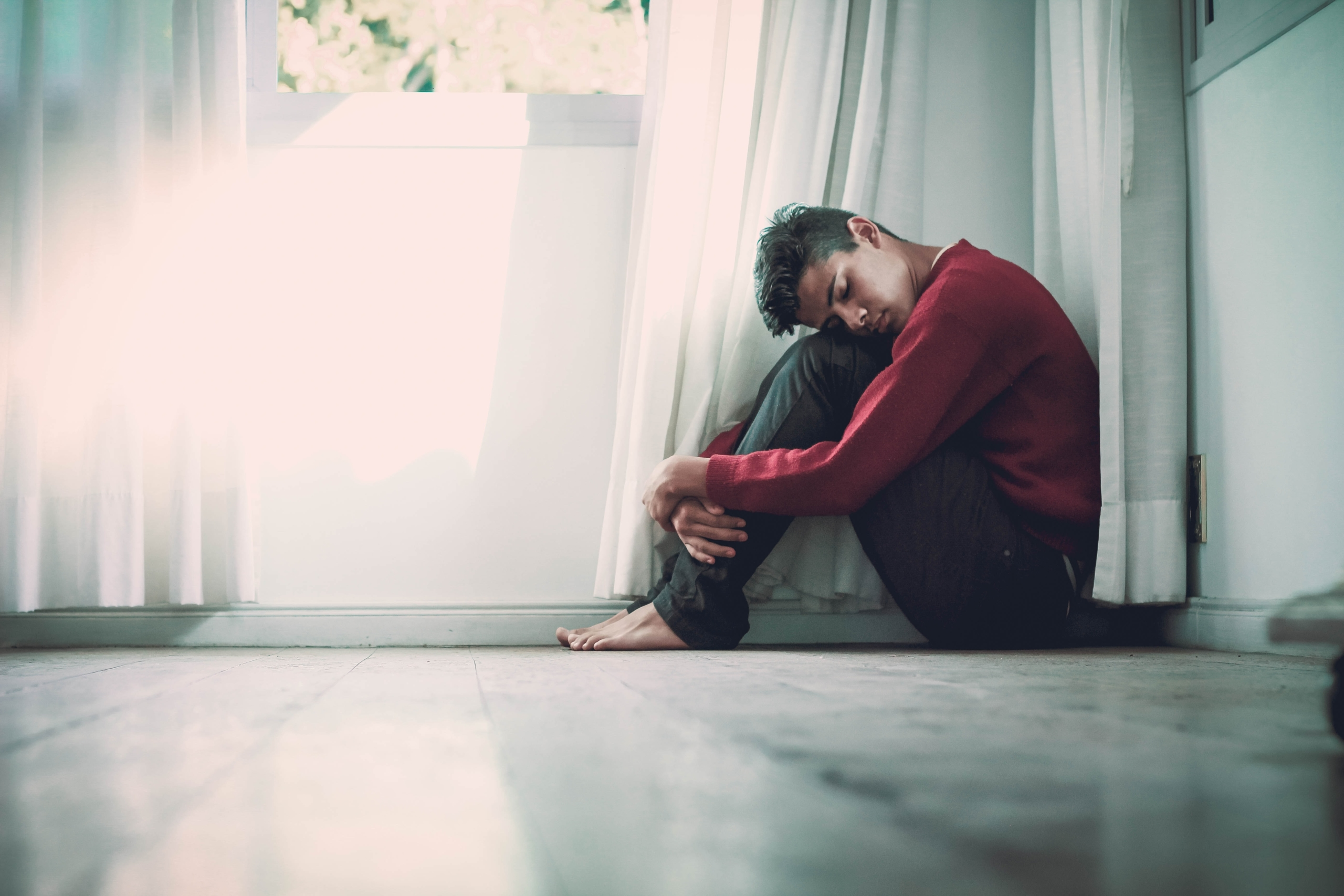 young-man-on-floor-depressed